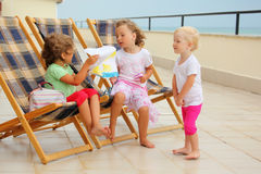 Girls In Lounge On Veranda, Considering Drawing Royalty Free Stock Photo