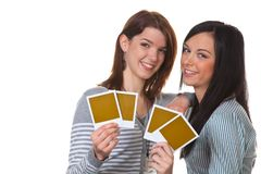 Girls with instant photos. Two girls with instant photos Stock Image