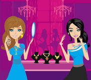 Girls at a jewelry store Royalty Free Stock Photos
