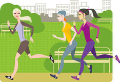 Girls jogging. Together in the park Royalty Free Stock Photo