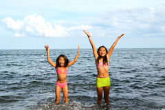 Girls Joy Inside The Water. Cute Asian girls expressing their joy inside the water stock photo