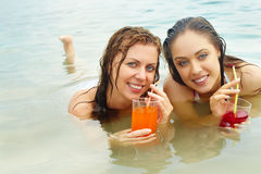 Girls with juice Stock Images