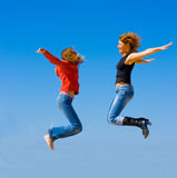 Girls jump. In a good mood Royalty Free Stock Photos