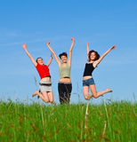 Girls jump on the meadow Royalty Free Stock Photography