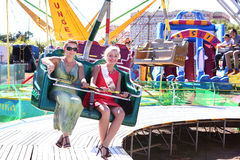 Girls jump on rotation attraction  in  amusement  park Moscow, Russia Royalty Free Stock Photo