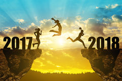 Girls jump to the New Year 2018. At sunset royalty free stock photography