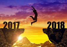 Girls jump to the New Year 2018. At sunset Royalty Free Stock Photo