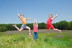 Girls jumping Royalty Free Stock Photo