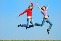 Girls jumping Royalty Free Stock Images