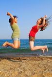 Girls jumping royalty free stock photography