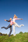 Girls jumping Stock Photo