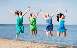 Girls jumping on the beach Stock Photo