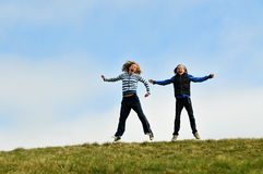 Girls jumping for joy Royalty Free Stock Photos