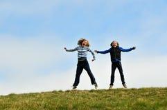 Girls jumping for joy royalty free stock photos
