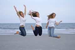 Girls Jumping For Joy on Beach Royalty Free Stock Photo