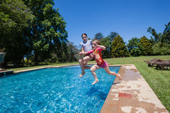 Girls Jumping Swimming Pool Royalty Free Stock Photography