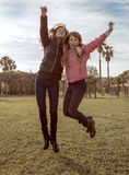 Girls jumping Royalty Free Stock Photos