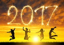 Girls jumps up in celebration of the New Year 2017. Girls jumps up in celebration of the New Year 2017 at sunset Royalty Free Stock Photo