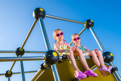 Girls and jungle gym Royalty Free Stock Images