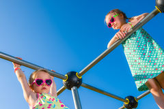 Girls and jungle gym Royalty Free Stock Image
