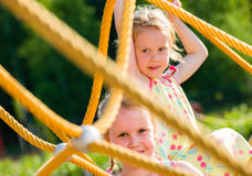 Girls and jungle gym Royalty Free Stock Photo