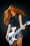 Happy teenager playing electric guitar. An happy teenager is having fun playing an electric guitar Stock Image