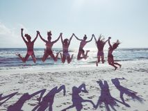 Girls just a wanna have fun. Girls jumping in mid air in florida royalty free stock photo