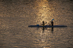 GIRLS KAYAKING AT SUNSET Stock Photo