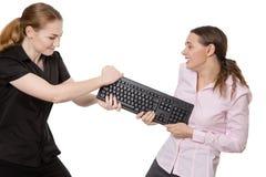 Girls keyboard fight Stock Photo