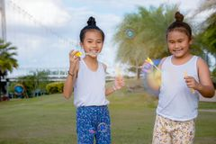 Girls kid happiness funny soap bubble in the park ,Laughing happy wi royalty free stock image