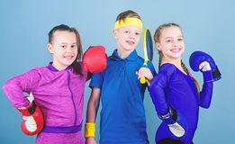 Girls kids with boxing sport equipment and boy tennis player. Ways to help kids find sport they enjoy. Sporty siblings. Friends ready for sport training. Child royalty free stock images