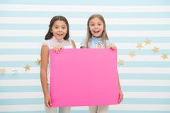 Girls kids hold advertisement poster copy space. Children hold advertising banner. Happy children with blank paper for. Advertisement. Advertisement concept stock image