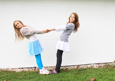 Girls - kids holding each other. Girls - smiling kids holding each other and dancing royalty free stock photography