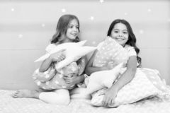 Girls kids hug cute pillow. Cute kids pillows they will love to cuddle. Find decorative pillows and add fun to room. Happy childhood cozy home. Adorable royalty free stock photo