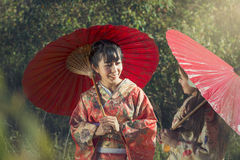 Girls in kimonos acting smile Stock Photography