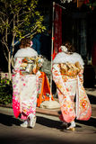 Women in Kimonos. Tokyo, Japan - January 12, 2015: Two woman dressed in a beautiful kimonos at Senso-Ji Temple in Asakusa, Tokyo on 'Coming of Age Day&#x27 Stock Image