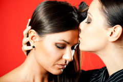 Girls kiss Royalty Free Stock Image