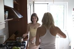 Girls in kitchen. Two girls cooking in the kitchen Stock Photography