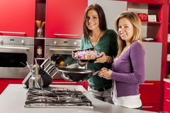 Girls in the kitchen Royalty Free Stock Images