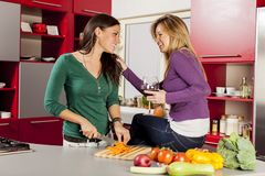 Girls in the kitchen Royalty Free Stock Photos