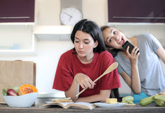 Girls in the kitchen Stock Photography