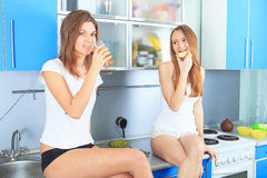 Girls in the kitchen Stock Photos