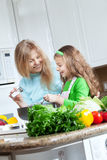 Girls on kitchen Royalty Free Stock Image