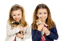 Girls with kittens Royalty Free Stock Photos