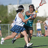 Girls Lacrosse defender blocking Royalty Free Stock Image