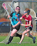 Girls Lacrosse defense 01 Royalty Free Stock Image