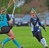 Girls Lacrosse defense Royalty Free Stock Photos