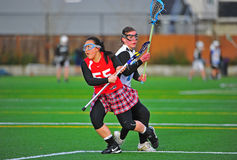 Girls Lacrosse eye on the ball Royalty Free Stock Photos