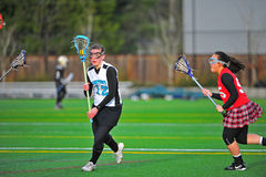 Girls Lacrosse lining up a shot Stock Photo