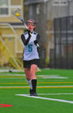 Girls Lacrosse player passing the ball Royalty Free Stock Images